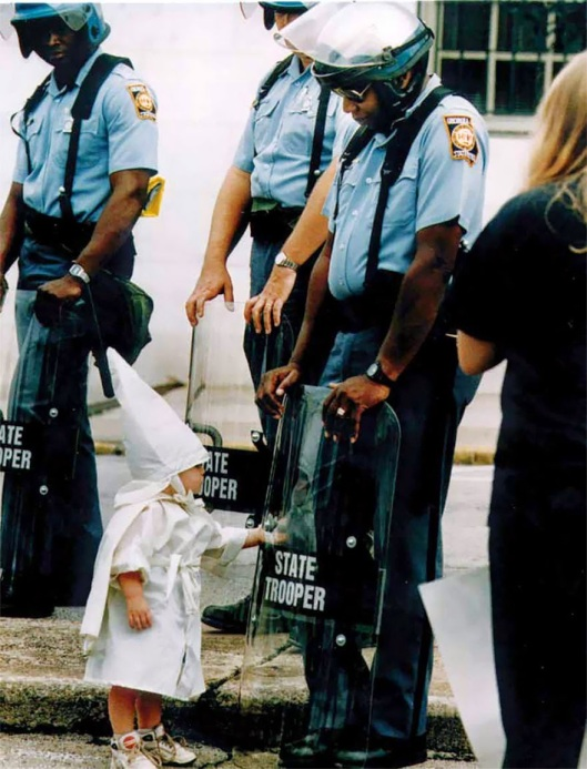 A KKK child and a black State Trooper meet each other, 1992 (by Todd Robertson)