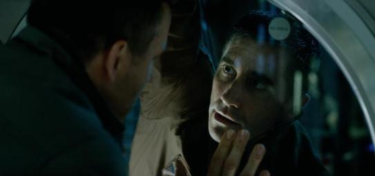 Adams (Reynolds) and Jordan (Gyllenhaal). Sony Pictures