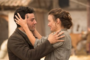 Mikael (Oscar Isaac) and Ana (Charlotte Le Bon). Photo by José Haro for Open Road Films.