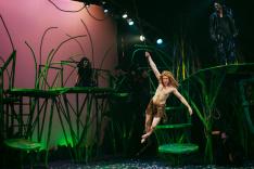Tarzan (Adam Donovan) swings across the jungle. Photo by Ben Krantz Studio.
