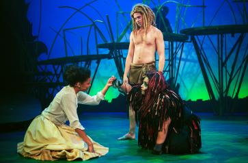 "Tarzan (Adam Donovan, standing) bridges the ""civilized"" world of Jane (Marissa Rudd) and Kala (Marisol Urbano). Photo by Ben Krantz Studio."