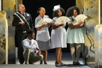 The chorus (Michael Gene Sullivan, Michael Curry [seated], Dawn L. Troupe, Omozé Idehenre, and Safiya Fredericks). Photo by Kevin Berne.