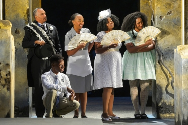 The chorus (Michael Gene Sullivan, Michael Curry [seated], Dawn L. Troupe, Omozé Idehenre, and Safiya Fredericks). Photo by Kevin Berne.