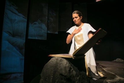 San (Nora el Samahy) reading The Way of Liv. Photo by Cheshire Isaacs for Crowded Fire Theater.
