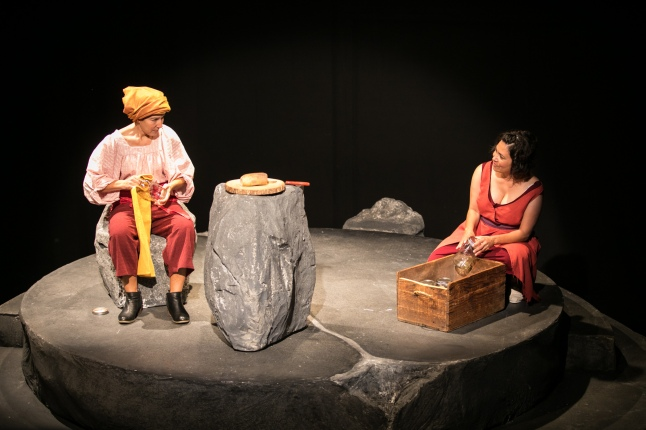 Gesalm (Michele Apriña Leavy) trades life stories with Rena (María Candelaria). Photo by Cheshire Isaacs for Crowded Fire Theater.