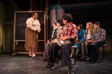 """Miss Shields (Katrina McGraw) instructs the children to write """"a theme"""". Photo by Jessica Palopoli."""