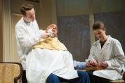 A Barber (Casey Robert Spiegel) shaves Harry Brock as a Manicurist (Melissa Quine) touches up his fingernails. Photo by Jessica Palopoli.