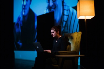 Katja (Emily Radosevich) reluctantly watches a vlog by Trent (Devin O'Brien) and Feldrick (Tyler McKenna). Photo by Jessica Palopoli for SF Playhouse.