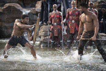 T'Challa (Chadwick Boseman) and Killmonger (Michael B. Jordan), with Janeshia Adams-Ginyard in the background. (c) Marvel Studios