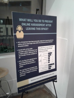 Lobby sign about online harassment. Photo by Me.