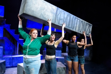 Cat Luedtke, Elissa Beth Stebbins, Leigh Rondon-Davis, and Karla Acosta take down the patriarchy brick by brick. Photo by Alessandra Mello.