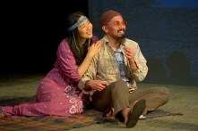 A pair of hippies (Cindy Im, JomarTagatac) show Quang a different side of America. Photo by Kevin Berne.