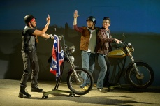 "A ""redneck biker"" (Jomar Tagatac) is very fond our Vietnamese guests (Stephen Hu, James Seol). Photo by Kevin Berne."
