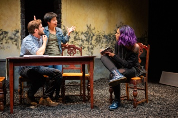 "Justin (Josh Schell) and Sarah (Sango Tajima) explain their ""bed-and-dinner"" vision to skeptical local blogger ""P"" (Sam Jackson). Photo by Jessica Palopoli."