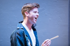 It's not enough for Gus (Adam Donovan) to be young, White, and successful in America. Photo by Ben Krantz.