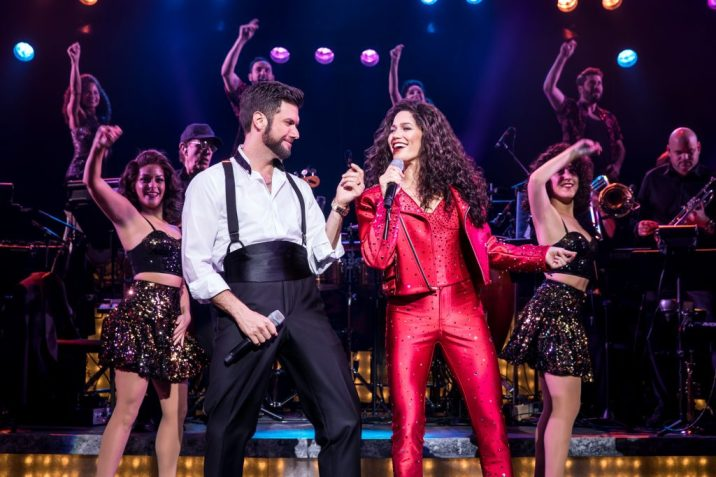 Emilio (Mauricio Martínez) and Gloria Estefan (Christie Prades) ride the wave of success. Photo by Matthew Murphy