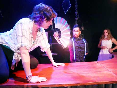 Elizabeth (Annika Bergman) tries to connect with Maggie (Adrian Deane, right), but the bartender (Enormvs Muñoz) won't let her. Photo courtesy of Theatre of Yugen.