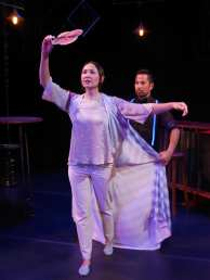 Roxy's (Stephanie Whigham) life is always in view of the bartender (Enormvs Muñoz). Photo courtesy of Theatre of Yugen.