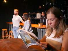 John (Paul Rodrigues) and Roxy (Stephanie Whigham) reminisce about Maggie (Adrian Dean, far-right) as the bartender (Enormvs Muñoz) looks on. Photo courtesy of Theatre of Yugen.