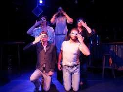 The ensemble, masked (masks by Liz Brent; cast, counter-clockswise from bottom-L: Alan Coyne, Annika Bergman, Stephanie Whigham, J.J. Van Name, Paul Rodrigues. Enormvs Muñoz in background.) Photo courtesy of Theatre of Yugen