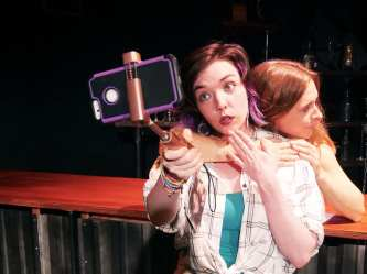 Elizabeth's (Annika Bergman) constant posts take her attention away from the loss of Maggie (Adrian Deane). Photo courtesy of Theatre of Yugen.