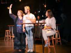 Aunt Helen (J.J. Van Name), John (Paul Rodrigues), and Roxy's (Stephanie Whigham) lives go on under the watchful eye of the mysterious bartender (Enormvs Muñoz). Photo courtesy of Theatre of Yugen.