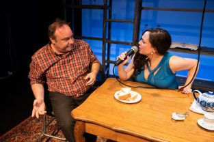 Ványa (George Saulnier) refuses to give up on his feelings for Yeléna (Virginia Blanco). Photo by Ben Krantz Studio.