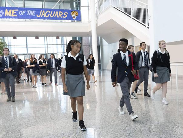 Starr Carter (Amandla Stenberg) and brother Seven (Lamar Johnson) are the only Black students of their posh prep school. Photo by Erika Doss for Twentieth Century Fox.