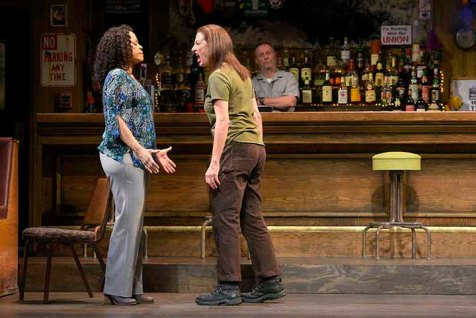 Cynthia (Tonye Patano) and Tracey (Lise Bruneau), once the best of friends, find themselves at odd when Cynthia is promoted. Stan (Rod Gnapp) watches the anger unfold. Photo by Kevin Berne.
