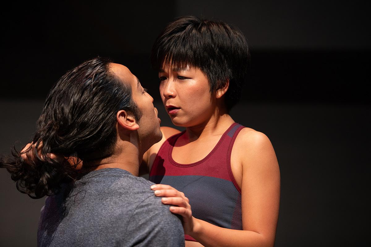 The callous Guy (Caleb Cabrera) enjoys taunting his fragile girlfriend Tori (Sango Tajima). Photo by Ben Krantz Studio.