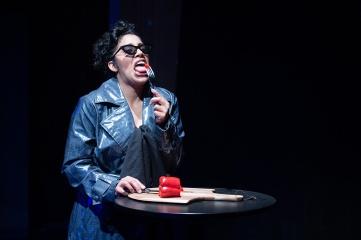 A woman (Regina Morones) makes dietary sacrifices. Photo by Ben Krantz Studio.