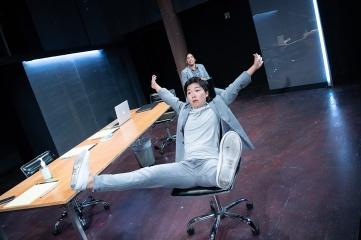 Two bros (Sango Tajima, foreground, Regina Morones, background) bro-ing out in a conference room. Photo by Ben Krantz Studio.