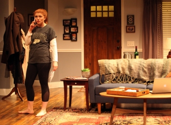 Campaign manager Macy (Emily Radosevich) may come home to Detroit, but that hasn't stopped her from berating her assistant back in NY. Photo courtesy of Magic Theatre.