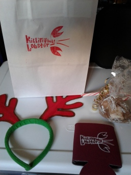 I won the night's raffle: reindeer antlers, a candy cane, cocoa & marshmellows, and a KML beer cozy. There truly is a Santy Claws. Photo by Me.