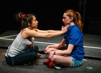 Rowena (Neiry Rojo, left) practices her latest spiritual trend on Blaze (Isabel Langen). Photo by Jessica Palopoli.