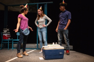 Rowena (Neiry Rojo), Blaze (Isabel Langen), and Gabe (Davied Morales) try to stay in high spirits celebrating their last birthday together. Photo by Jessica Palopoli.