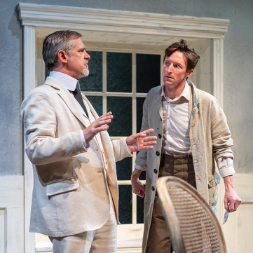Gustav (Jonathan Rhys Williams) tells Adolph (Joseph Patrick O'Malley) some unflattering things about the latter's wife. Photo by David Allen for Aurora Theatre