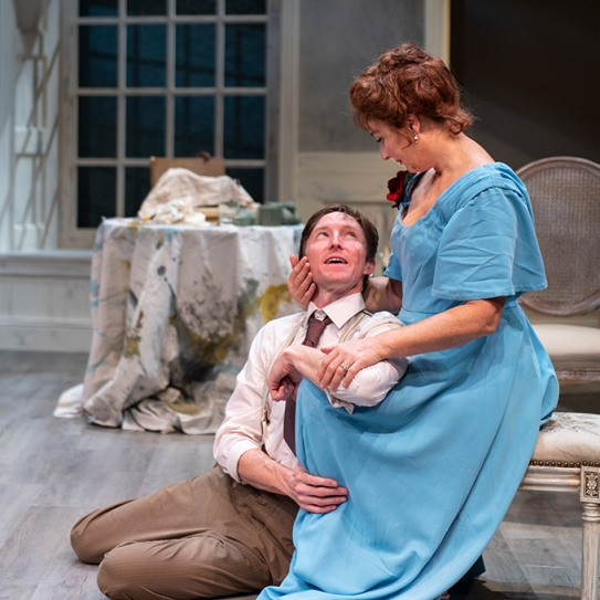 Photo by DavidAdolph's (Joseph Patrick O'Malley) finds comfort in the loving embrace of his wife, Tekla (Rebecca Dines). Allen for Aurora Theatre