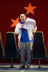 Coach Saul (Arye Gross) gives his team a quickie lesson on Chinese policy. Photo by Kevin Berne.