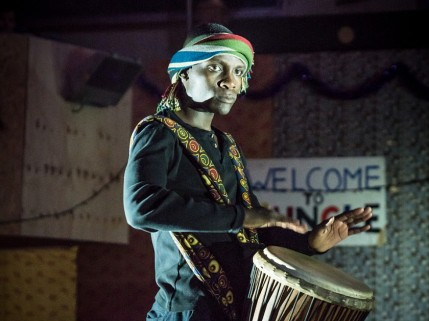 Even Okot (John Pfumojena) finds a moment for music. Photo By Marc Brenner