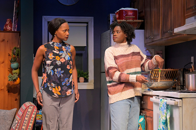 Inia (Eunice Woods) clearly doesn't think much of Adiaha's (Aneisa Hicks) cooking. Photo by Kevin Berne.