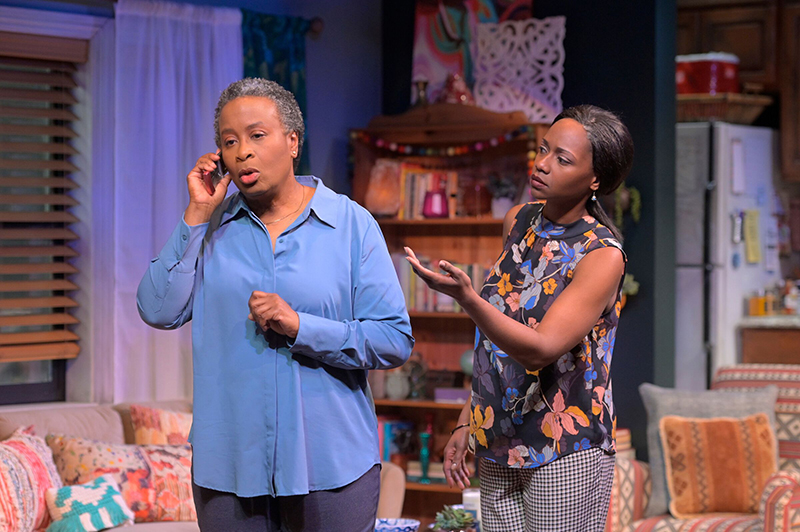 Abasiama (Kimberley Scott) is so eager to speak to her grandson that mother Iniabasi (Eunice Woods) can barely get a word in. Photo by Kevin Berne.