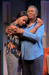 Inia (Eunice Woods) and Abasiama (Kimberly Scott) make the connection for which they've been longing. Photo by Kevin Berne.
