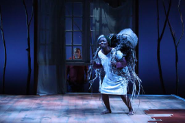 Azel (Steven Anthony Jones, outside) isn't sure what to make of the sight of Abasiama (Nancy Moricette) being haunted. Photo courtesy of Magic Theatre.