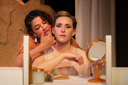 The Servant (Leticia Duarte) takes Helen (Adrian Deane) through the routine they've exercised day after day. Photo by Devlin Shand
