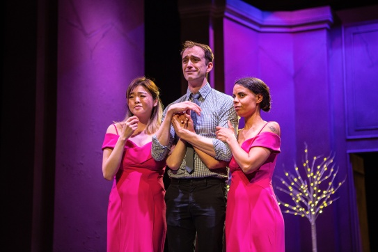 Laura (Ruibo Qian), Jordan (Kyle Cameron), and Vanessa (Nicole-Azalee Danielle) are all used to being bridesmaids, but one of them will never be a bride. Photo by Jessica Palopoli.