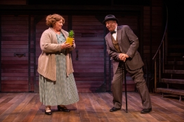 Fräulein Schneider (Jennie Brick) wasn't expecting a pineapple from Herr Schultz (Louis Parnell), and that's why she loves it. Photo by Jessica Palopoli.