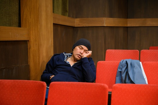 A sleeping patron (Rob Dario) turns the simple act of cleaning into more work than usual. Photo by Ben Krantz Studio.